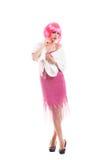 La muchacha rosada del pelo vestida como Merelyn Monroe aisló Fotos de archivo libres de regalías