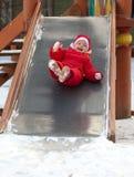 La muchacha rueda abajo en diapositiva del patio Imágenes de archivo libres de regalías