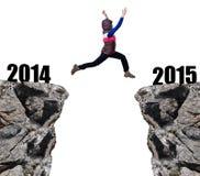 La muchacha salta al Año Nuevo 2015 Imagen de archivo