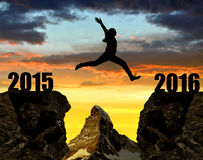 La muchacha salta al Año Nuevo 2016 Imágenes de archivo libres de regalías