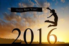 La muchacha salta al Año Nuevo 2016 Fotos de archivo