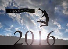 La muchacha salta al Año Nuevo 2016 Imagenes de archivo