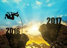 La muchacha salta al Año Nuevo 2017 Fotografía de archivo