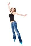 La muchacha salta con felicidad. Fotos de archivo libres de regalías