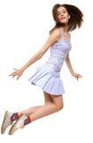 La muchacha salta hacia adelante Imagen de archivo