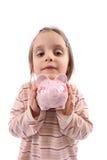 La muchacha salva el dinero Fotografía de archivo libre de regalías