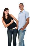 La muchacha señala su dedo en el muchacho aislado en blanco Imagenes de archivo