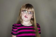 La muchacha se encrespa los labios Fotos de archivo