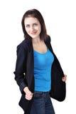 La muchacha se vistió en chaqueta, camiseta y vaqueros azul marino Fotografía de archivo