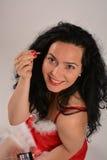 La muchacha se vistió en Santa Claus con el equipo del maquillaje, mirando para arriba Fotos de archivo libres de regalías