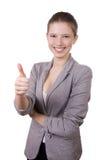 La muchacha sonriente en una chaqueta gris Imágenes de archivo libres de regalías