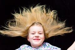 La muchacha sonriente hace que las caras imitan a la bruja Fotografía de archivo libre de regalías