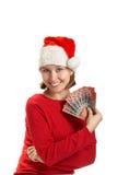 La muchacha sostiene billetes de banco en una mano Fotografía de archivo