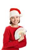 La muchacha sostiene billetes de banco en una mano Fotos de archivo libres de regalías
