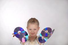 La muchacha sostiene el CD Fotografía de archivo libre de regalías