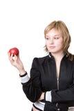 La muchacha sostiene una manzana Imagen de archivo libre de regalías