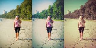 La muchacha tailandesa asiática está caminando a lo largo de la costa de la playa de Tailandia Foto de archivo libre de regalías