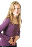 La muchacha tiene dolor abdominal Fotografía de archivo libre de regalías