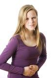 La muchacha tiene dolor abdominal Fotos de archivo