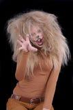 La muchacha tiene gusto de un león fotos de archivo libres de regalías