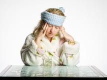 La muchacha tiene un dolor de cabeza Fotos de archivo