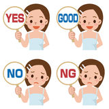 La muchacha tiene una placa de la muestra de contestar a correcto o a incorrecto Imagenes de archivo