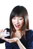 La muchacha toma la medicina Imágenes de archivo libres de regalías