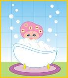 La muchacha toma un baño con espuma Fotografía de archivo libre de regalías