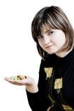 La muchacha toma una píldora Imagen de archivo