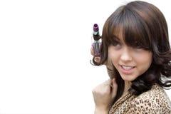 La muchacha, torciendo el pelo Imagen de archivo