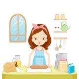La muchacha trilla la harina con la tableta Imagen de archivo