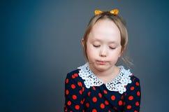 La muchacha triste en un vestido Imagen de archivo libre de regalías