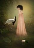 La muchacha triste y la grúa Foto de archivo libre de regalías