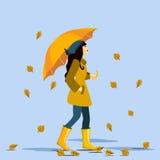 La muchacha va con un paraguas en la lluvia Autumn Time Vector Fotografía de archivo libre de regalías