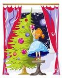 La muchacha viste para arriba el árbol de navidad Imagenes de archivo