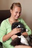 La muchacha y el gato Fotografía de archivo