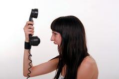 La muchacha y el teléfono Fotografía de archivo libre de regalías