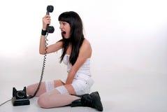 La muchacha y el teléfono Imagen de archivo libre de regalías