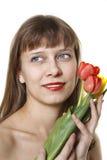 La muchacha y los tulipanes Foto de archivo libre de regalías