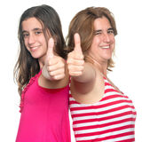La muchacha y su hacer de la madre los pulgares suben gesto de mano Fotografía de archivo libre de regalías