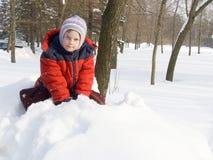 La muchacha y una nieve Fotografía de archivo libre de regalías