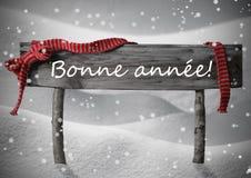 La muestra Bonne Annee de la Navidad significa el Año Nuevo, nieve, copos de nieve Fotos de archivo