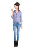 La mujer aislada está presentando con el dedo índice. Fotos de archivo libres de regalías