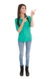 La mujer aislada está señalando con el finger. Fotografía de archivo libre de regalías