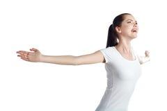 La mujer alegre con los brazos aumentó extendido Imagen de archivo