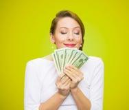 La mujer ama el dinero Fotografía de archivo libre de regalías
