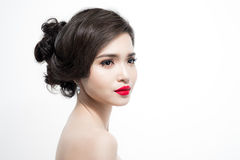La mujer asiática hermosa con la piel pura, agradable compone fotos de archivo