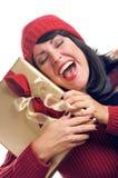 La mujer atractiva sostiene el regalo Imagen de archivo libre de regalías