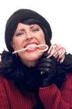 La mujer atractiva sostiene los bastones de caramelo Fotografía de archivo
