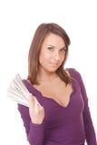 La mujer atractiva toma la porción de 100 cuentas de dólar Foto de archivo libre de regalías